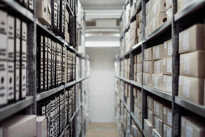 Long corridor of shelves in an archive